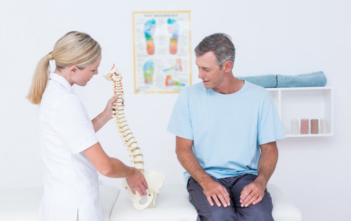 female chiropractor with patient