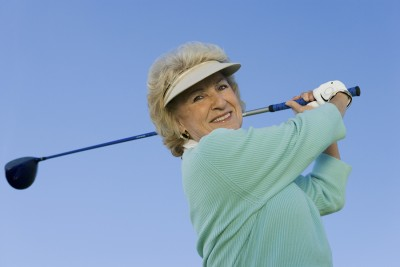 Donna is able to golf again after treatment at the Heilman Center.