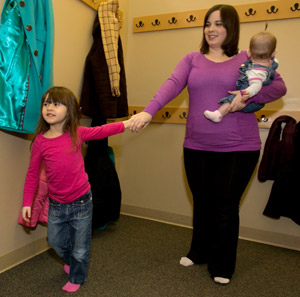 A woman with her kids after receiving treatment for chronic pain